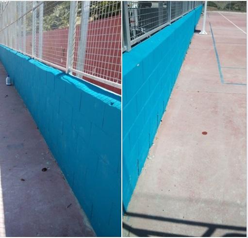 Pintado de un perímetro extenso de murete Pista Deportiva Jardín de Málaga